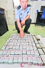 警方摧毁电话诈骗团伙缴获5千张身份证(图)