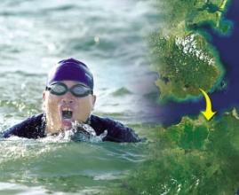 46岁男子用时12小时横渡琼州海峡(图)