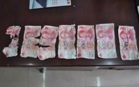 六旬老太装可怜求换零钱 被识破当场吞假钞